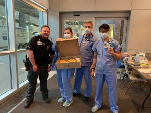 doctors at cox south ER holding boxes of pizza delivered by Vito's Kitchen