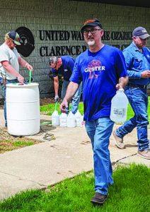 Greg Burris distributes hand sanitizer.