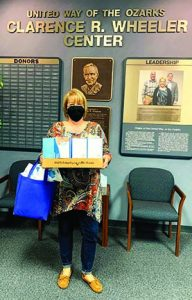 Lisa Farmer of Harmony House receives Covid relief supplies.